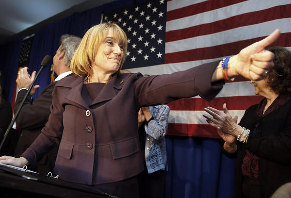 New Hampshire Gov. Maggie Hassan acknowledges supporters on Nov. 4 after winning reelection in New Hampshire, where lawmakers are facing a $50 million budget gap and debates about minimum wage, casinos and concealed weapons.
