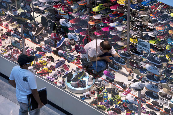 A costumer stops by a sneaker display at a shopping mall in the outskirts of Sao Paulo.