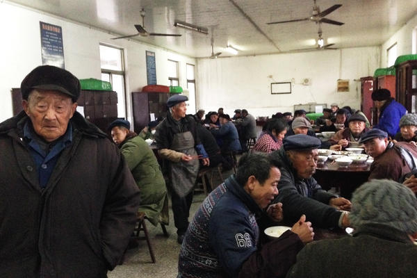 Senior citizens eat dinner in the unheated dining room of their government-funded retirement home in rapidly aging Juegang Township, Rudong County, in eastern China's Jiangsu province. Just a few years ago, the town had only one such facility; now it has five.