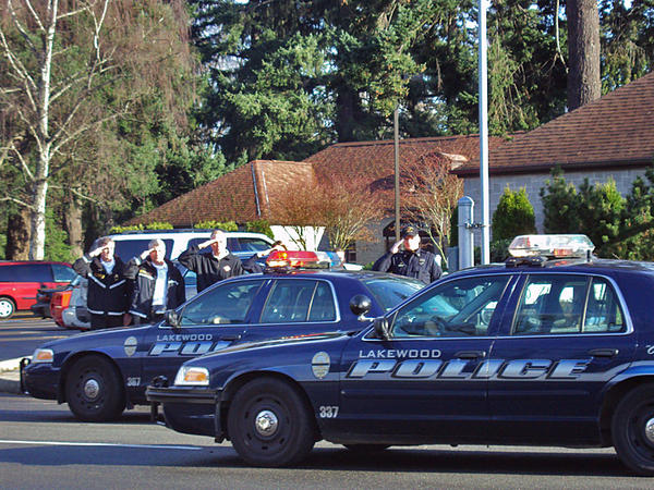 2009 file photo of Lakewood, Washington, police cars at a memorial for the four officers killed by Maurice Clemmons on Thanksgiving weekend.