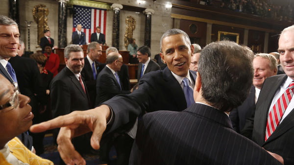 President Obama greets lawmakers as he leaves after delivering the 2014 State of Union address to a joint session of Congress.