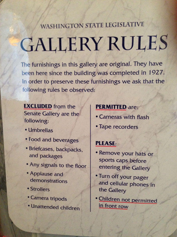 The signs outside the Washington House and Senate public viewing galleries make it clear what is not allowed inside. The list includes umbrellas, backpacks and strollers, but not firearms.