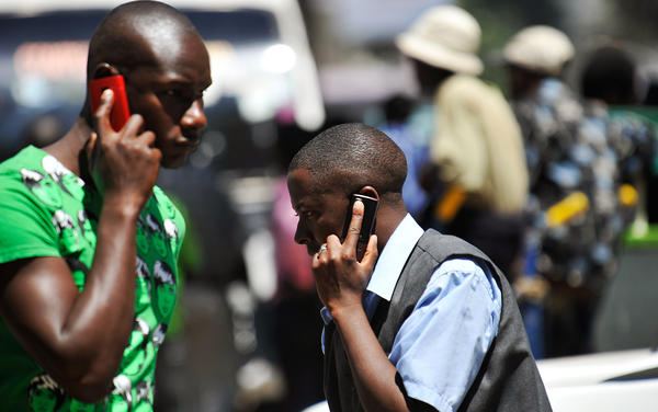Cellphones are everywhere in the developing world, as this Nairobi street scene shows. Bill and Melinda Gates believe the phones can be used for everything from farmer education to instant banking.
