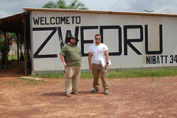 Marc Bouma, left, of Tacoma, and Robert Rains the team logistical expert, after landing at the airport of Zwedru, Liberia. Their mission was to build and staff a new Ebola Treatment Center in this remote town.