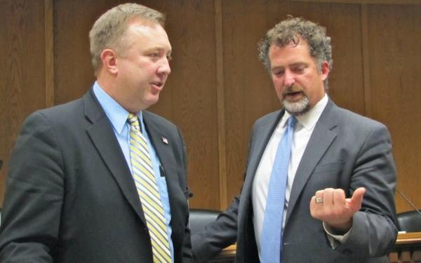 <p>Senator Doug Ericksen (R-Ferndale) talks with Senator Kevin Ranker (D-Orcas Island) after a committee meeting at the Washington State senate. </p>