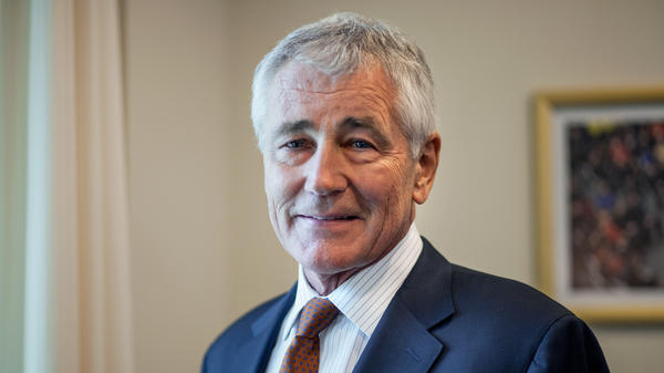 Secretary of Defense Chuck Hagel, shown here in his Pentagon office Friday, explained that transferring Guantanamo Bay detainees required action from many parts of the federal government.