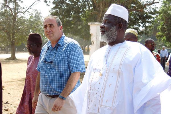 The Grand Imam of Guinea, El Hadj Mamadou Saliou Camara, walks through the streets of Kindia with U.S. Ambassador, Alex Laskaris. Together they hope to end Ebola denial.