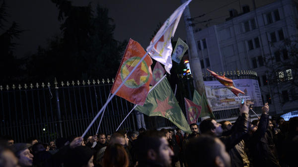 Kurds in Istanbul wave the flags of the outlawed PKK on Monday after Kurdish fighters backed by U.S.-led airstrikes pushed the Islamic State group out of Kobani, Syria.