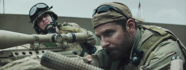 Bradley Cooper (right) plays Chris Kyle in <em>American Sniper</em>. The film has become a cultural phenomenon and has spawned knee-jerk squabbling.