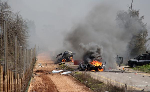 Israeli military vehicles are seen burning in the Shebaa farms an occupied area along the Israeli-Lebanese border near Ghajar village, on January 28, 2015, following a Hezbollah missile attack. A missile attack killed two Israeli soldiers and Israel responded with air and ground strikes on southern Lebanon, where a UN peacekeeper was killed. (Maruf Khatib/AFP/Getty Images)