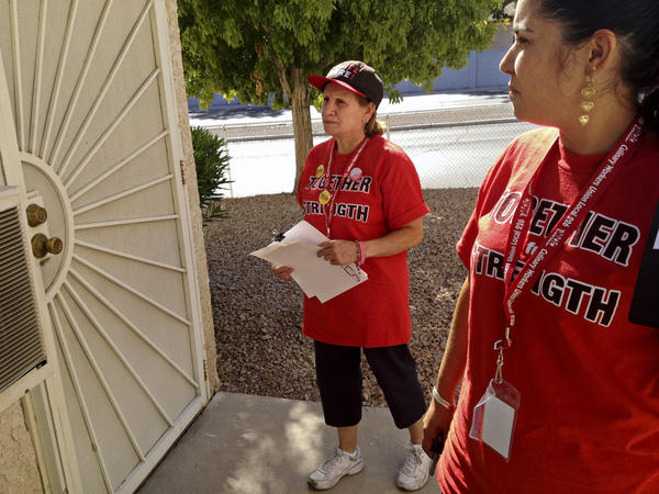 Culinary Union members Emilia Cabrera (left) and Dallany Santos canvass in Las Vegas for the union's get-out-the-vote effort for President Obama.