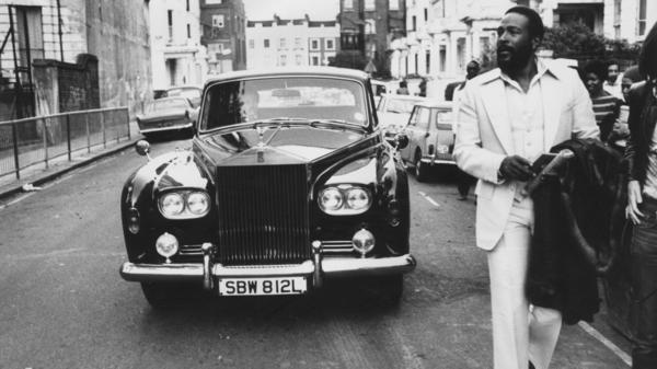 Marvin Gaye walks ahead of his Rolls Royce in Notting Hill, London, in 1976.