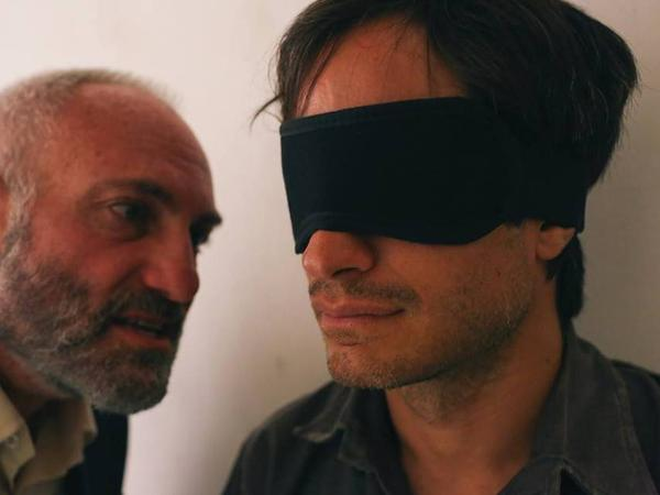 Gael Garcia Bernal is an imprisoned Iranian journalist in Jon Stewart's directorial debut, <em>Rosewater.</em>