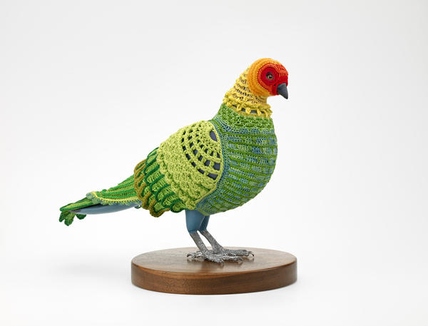 Laurel Roth Hope, <em>Biodiversity Reclamation Suit: Carolina Parakeet</em>, 2009. Suit: cotton, silk, bamboo, wool and acrylic blended yarn; mannequin: basswood, acrylic paint, gouache, glass, pewter and walnut.
