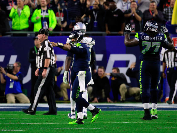 Seahawks quarterback Russell Wilson (3) reacts after throwing an 11-yard touchdown pass late in the second quarter.