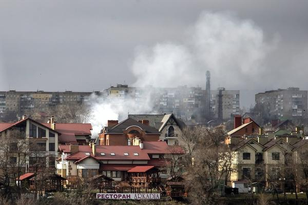 Smoke rises above buildings after shelling in Donetsk, Ukraine, on Tuesday. The number of people who have been killed in the conflict in eastern Ukraine has climbed to 5,358, with the escalating violence claiming an average of 10 lives per day in the past few weeks, the U.N. says.