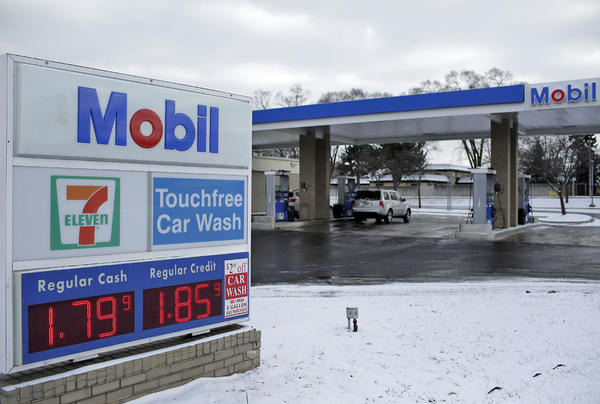 Regular gas cash price is displayed for $1.79 a gallon at a Mobil station January 6, 2015 in Livonia, Michigan. BP and Exxon Mobil attribute their loss in earnings to the steep fall in oil prices. (Joshua Lott/Getty Images)