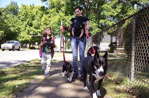 Juniper Russo walks her dogs with her daughter Vivian (left).