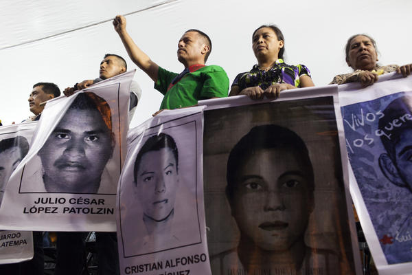 Family members of 43 missing students from Guerrero State in Mexico protest in the Zocalo to demand answers from the government of the missing students on November 5, 2014 in Mexico City, Mexico. (Brett Gundlock/Getty Images)