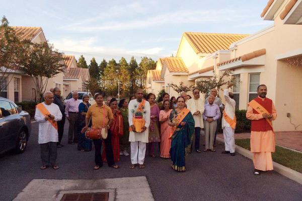 Residents of ShantiNiketan, a retirement community near Orlando, Fla., walk in a Hindu religious procession.
