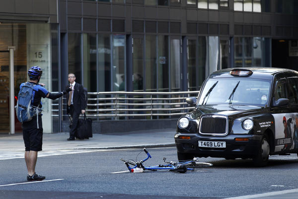 A cyclist reacts after coming off his bike in an incident with a taxi in London in 2011.