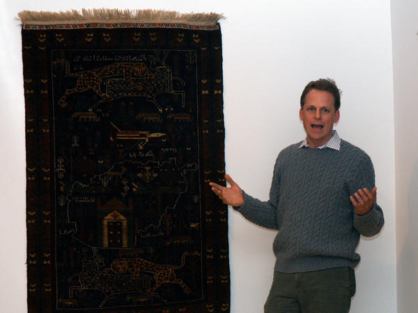 "Kevin Sudeith, shown at a 2005 exhibit in Davidson, N.C., collects, <a href=""http://warrug.com"">shows and sells Afghan war rugs.</a>"