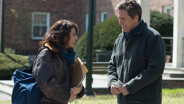 Marisa Tomei and Hugh Grant star in <em>The Rewrite</em>.