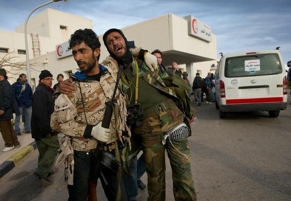 A soldier with the opposition weeps outside of the hospital in Ras Lanuf in Eastern Libya in March 2011 as soldiers are being brought in wounded and dead from the front line during heavy fighting.