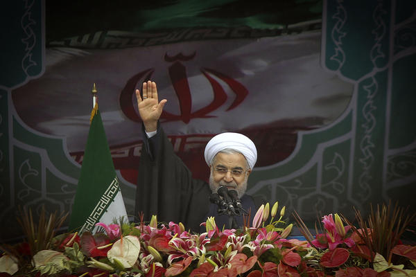 Iran's President Hassan Rouhani waves during a rally to mark the 36th anniversary of the Islamic revolution at Azadi Square in Tehran on Wednesday. President Hassan Rouhani delivered a speech saying the world needs Iran to help stabilize the troubled Middle East, in remarks pointing to wider ramifications of a deal over its disputed nuclear program.