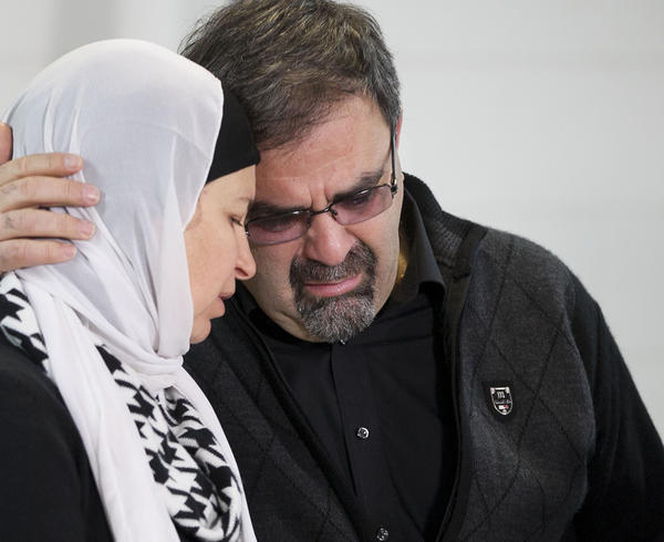 Namee Barakat embraces his wife Layla Barakat during a news conference at the Swift Creek Exchange Club on Wednesday, in Raleigh, N.C.