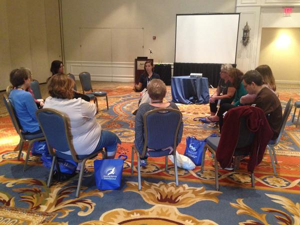 Michele Neff Hernandez, executive director for Soaring Spirits International, leads a conversation with a group of Camp Widow alumni at the Tampa Marriott Waterside Hotel & Marina.