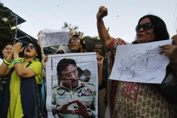 Musharraf supporters chant slogans on his behalf in Karachi on April 2, 2014.