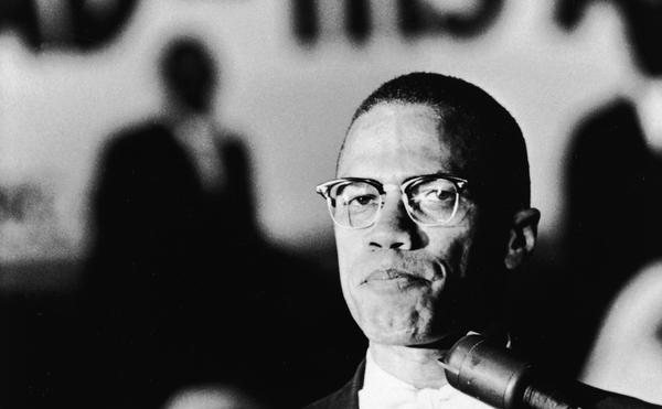 American civil rights activist Malcolm X (1925 - 1965) speaks at a podium during a Black Muslim rally in Washington DC, circa 1963. (Hulton Archive/Getty Images)