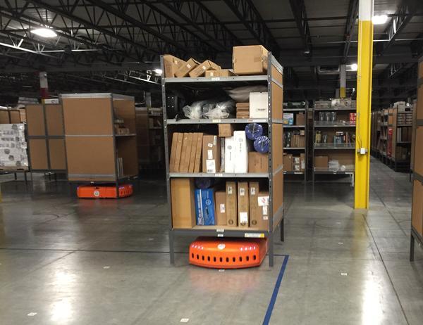 Orange shuttle robots, which stash and retrieve merchandise