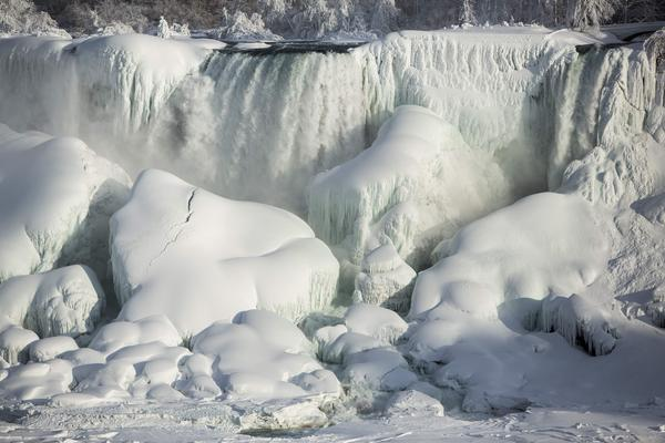 A partially frozen American Falls in sub-freezing temperatures is seen in Niagara Falls, Ontario, on Tuesday. Temperature dropped to 6 degrees Fahrenheit on Tuesday. The National Weather Service has issued a wind chill warning for western New York from midnight Wednesday to Friday.