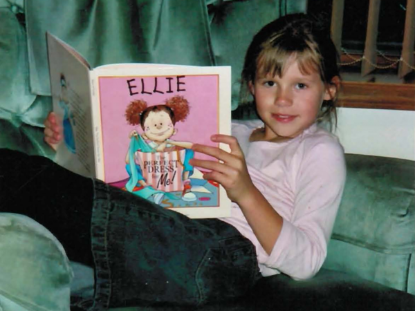 Alyssa Hemmelgarn reading a book. Alyssa died shortly after being diagnosed with leukemia.  (Courtesy of Hemmelgarn family)
