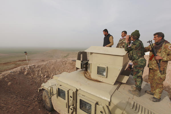 Kurdish Peshmerga fighters take positions on the outskirts of Mosul on Jan. 26. The U.S. military says an offensive to drive the Islamic State out of Mosul is expected around April or May.
