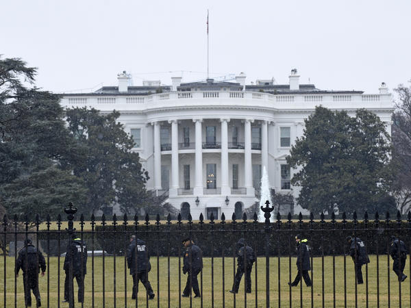 Secret Service officers search the White House grounds on Jan. 26 after an unmanned aerial drone was found there during the middle of the night.