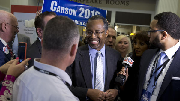 Ben Carson talks with media after his CPAC speech.