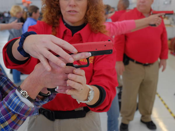 Colorado educators take part in a concealed carry course in Englewood, Colo., on Nov. 8. The course is open to all state school employees. Participants who complete the training are eligible to apply for a permit to carry a handgun.