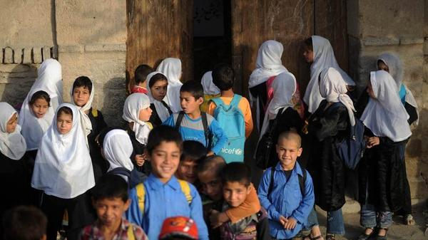 Afghanistan is a country of the young: According to best estimates, at least half the population was under age 10 when the Sept. 11 attacks took place a decade ago. Now, a generation of Afghans has very little knowledge about the events that so transformed their country. In this photo, Afghan children gather for school in Old Kabul in August 2010.