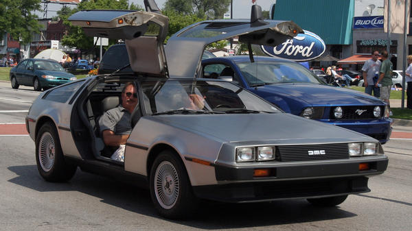 <p>A 1981 DeLorean is seen in a commemorative cruise in Michigan. A Texas company plans to make electric versions of the iconic car.</p>