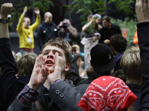 Lucas Brinson, 21, takes on the role of a human microphone, relaying information throughout New York City's Zuccotti Park Occupy Wall Street encampment days before protests were cleared out by police in mid-November.