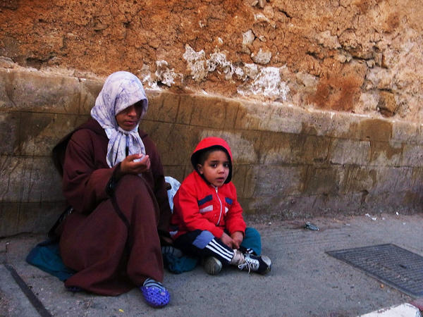 A Moroccan mother and child beg for money in Rabat, Morocco, last year. About 15 percent of the population lives on $2 a day, and the literacy rate is little more than 50 percent.