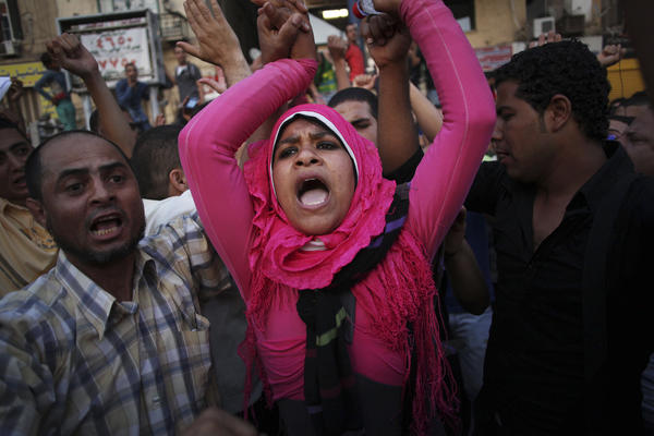 Egyptian protesters chant slogans against the country's military ruling council and presidential candidate Ahmed Shafiq in Tahrir Square in Cairo, Egypt on Thursday.