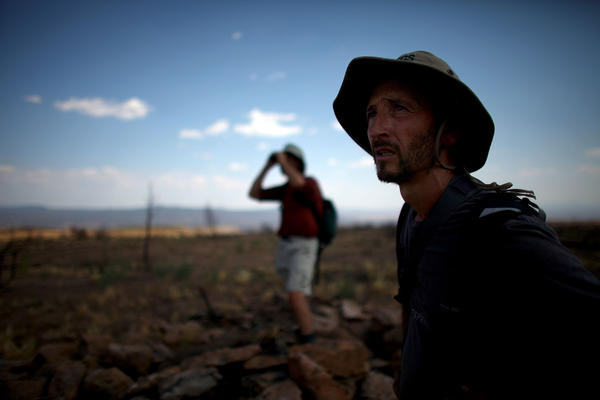 Allen (left) and Castro look across the wasteland of a plateau reduced to ashes during the Las Conchas fire. Because the fires stripped vegetation from hillsides, these areas are now vulnerable to flash floods during the summer rains.