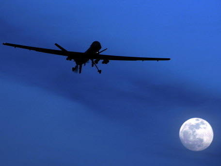 A U.S. Predator drone flies through the night sky over Kandahar Air Field in Afghanistan. Drone strikes ordered by the Obama administration have killed more than a dozen al-Qaida leaders around the world.