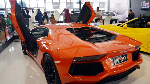 "The Italian-built Lamborghini Aventador costs nearly $400,000. The money spent on election 2012 — for TV ads and other things — could theoretically get you more than 15,000 of these V12 cars. But that's a lot more than <a href=""http://www.autoguide.com/auto-news/2012/07/lamborghini-aventador-reaches-production-milestone.html#more-145476"">have been built</a>."