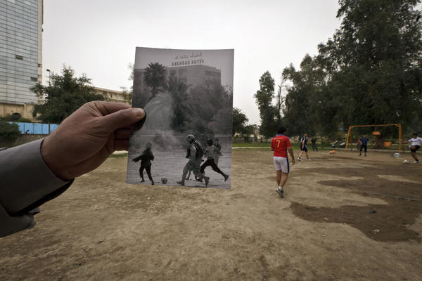 Abu Nawas park in Baghdad, the site of a 2003 photograph taken by Maya Alleruzzo, shows Iraqi orphans playing soccer with a U.S. soldier from the 3rd Infantry Division.