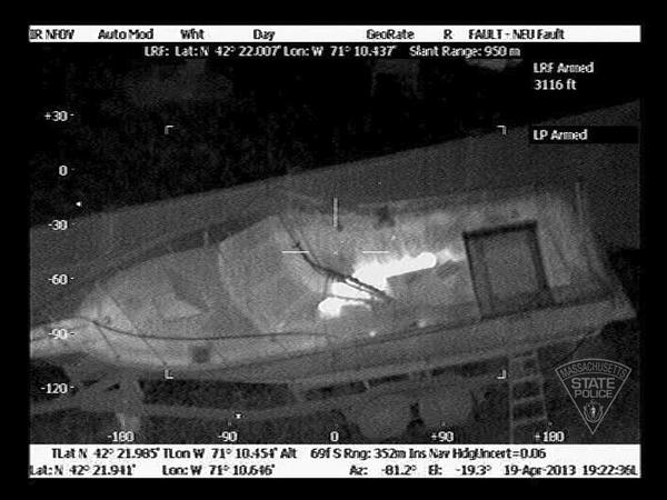 An infrared photograph taken from a police helicopter shows Tsarnaev in the boat's cockpit.